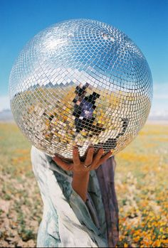 fixing the rest of my disco balls and hanging them outside