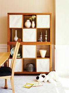 How to Make Bookcase Shades -use tension rods and canvas or twill. No need to find the right size box to hide things in.