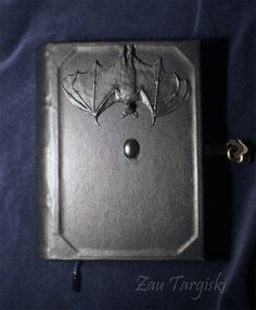 Book of shadows with a bat. 300 sheets of A5 format, genuine leather, polymeric clay