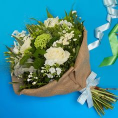 Bloom Magic - Flower Delivery Ireland - Simplicity is pure and gorgeous. This bouquet features white roses and the freshest seasonal white blooms available. Artfully hand-tied with luxurious greenery, this bouquet is perfect for any occasion. Send Flowers Online, Anniversary Flowers, Same Day Flower Delivery, Flowers Delivered, North Beach, Seasonal Flowers, White Roses, Greenery, Ireland
