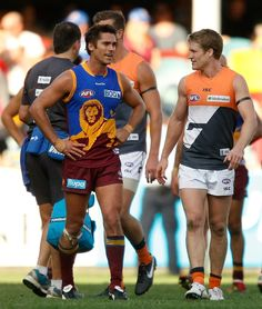 Simon Black (Brisbane Lions) and Luke Power (GWS Giants) after round 8, 2012. Still old friends.