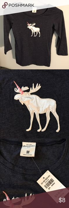 🆕 Abercrombie Kids Navy Unicorn/Moose Shirt Adorable and *New With Tag* Never Worn. My daughter outgrew it before the long sleeved season started. So cute! 👗All items are mine and were purchased by me for my use. 📩 Mailed same/next day! ✅ Make offers via the offer button.  ❌ No lowball offers. Keep in mind the 20% Posh fee that will be deducted as well. abercrombie kids Shirts & Tops Tees - Long Sleeve