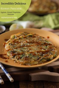 Korean Scallion Pancake Korean Eggless Pancake or Buchimgae is an easy recipe that takes hardly 10 minutes to cook. Crispy outside and creamy soft inside, these Korean Vegetable pancakes with dipping sauce are totally addictive. Vegetarian Pancakes, Vegetable Pancakes, Tasty Pancakes, Vegetarian Recipes, Vegan Vegetarian, Veg Recipes, Vegan Meals, Indian Food Recipes, Asian Recipes