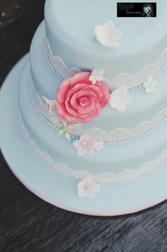 Gorgeous sky blue wedding cake with gorgeous flower details. Pink rose and lace effect on the cake. www.folegaphotography.co.uk