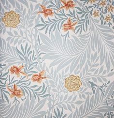 Larkspur Wallpaper A sweeping floral wallpaper featuring pretty russet flowers with duck egg blue foliage on a cream background.