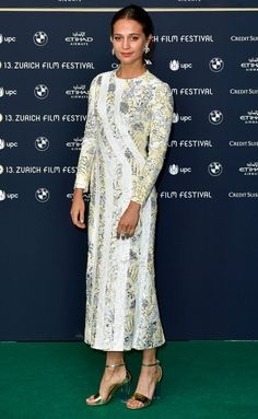 Alicia Vikander in a floral Louis Vuitton midi dress