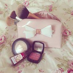 Cute bow makeup bag and products #makeup #bow #makeupmayhem