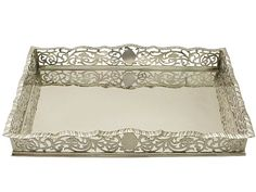'Edwardian Tray in Sterling Silver' http://www.acsilver.co.uk/shop/pc/Sterling-Silver-Gallery-Tray-Salver-Antique-Edwardian-66p9182.htm