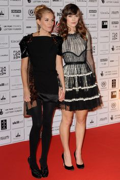 December 2008 With Edge of Love co-star Keira Knightley at the British Independent Film Awards in London. Miller opted for a Louis Vuitton spring/summer 2009 dress and satin Christian Louboutin heels, while Knightley wore a high-necked lace and tulle dress.