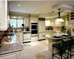 Kitchen near the beach.....Features antique glazed backsplash with green and pink toned granite