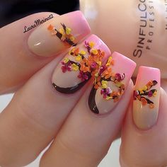 Beautiful pink themed leaf nail art design. The French tips are painted with a gradient pink while the brown tree painted is decorated with pastel embellishments on top for the leaves.