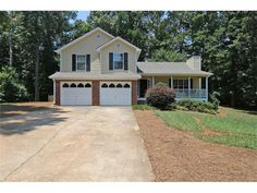 4812 Mceachern Way - Mceachern HS  Freshly painted inside & out, you'll fall in love with the open floor plan in this move-in ready home. Glowing refinished hardwood floors are throughout the main level and brand new carpet in all the bedrooms. Bedroom 4 can serve as a media/recreation room and includes a half bath. The kitchen features granite counter tops, stained cabinetry and an island w/ a breakfast bar. The backyard is level, fenced & private with an over-sized new deck for…
