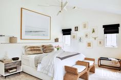 Inside the World's Chicest Log Cabin// White bedroom with neutral accents and woven stools