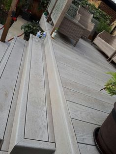 Advanced Building & Construction builds decks, patios and porches in any style or design from various materials to accommodate your lifestyle and budget. Laying Decking, Decking Area, Pvc Decking, Decking Boards, Deck Design, Garden Design, Landscaping Design, Raised Deck, Deck Construction