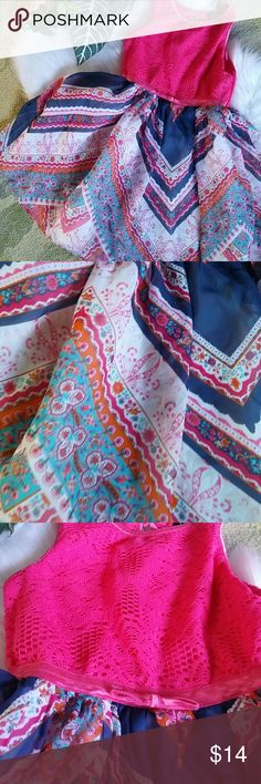 Little girls beautiful summer dress This is a gorgeous beautiful summer dress with pink top in gorgeous detail bottom with blues and orange and turquoise and pink. Size 5 in great condition. One small snack at tap but can hardly notice see pictures for details Dresses