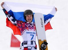 Gold medalist Vic Wild of Russia celebrates during the flower ceremony for the Snowboard Men's Parallel Giant Slalom Finals. Sochi 2014 Day 13 - Snowboard Men's Parallel Giant Slalom. © 2014 XXII Winter Olympic Games.