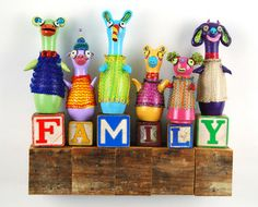 """Reina Mia Brill -Family 2011 Wall Sculpture 11"""" x 11"""" x 2.5"""" wood, clay, knitted wire, paint, vintage alphabet blocks"""