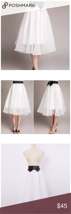 """Layered White Black Tulle Organza Swing Skirt ‼️ PRICE FIRM UNLESS BUNDLED WITH OTHER ITEMS FROM MY CLOSET ‼️   Organza Swing Skirt Size One Size  Retail $99  SPECTACULAR! Words can not describe how beautiful this skirt is. One size, waistband stretches to fit your waist. 100% polyester lining with a spandex elastic waistband. Outside layer is organza. Please check my closet for many more items including designer clothing, scarves, jewelry, handbags, shoes & much more.  Waist up to 36""""…"""
