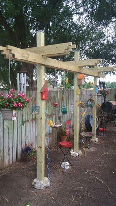 Bird feeding station with many feeders and watering trays that we built and enjoy watching from our sunroom.