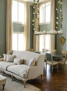 An indoor swing holding dozens of little candles?! P.S. That wall color is divine.