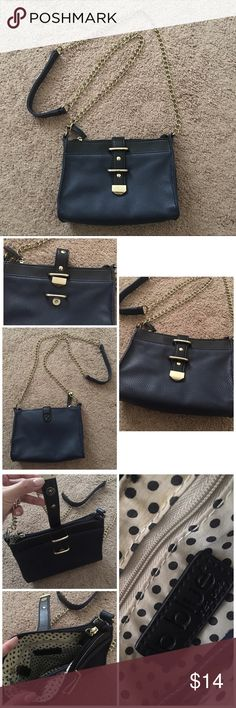 """‼️NAVY & GOLD CHAINED CROSSBODY PURSE‼️ Cross body bag worn twice. Front clasp is a little scratched but unnoticeable and inside of the bag has a slight stain (pictured). Overall the purse is in very good condition with minimal signs of wear. Inside purse has a zipped section and a small pocket. Dimensions are 8"""" x 2.5"""" x 6"""" and strap drop is 23"""". IP BLUE HEEL PELE Bags Crossbody Bags"""