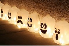 Make your sidewalk spooky (and safe) for Halloween with Ghost Lanterns made from milk jugs.