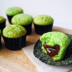 Fragrant and moist Pandan Cupcakes encasing a sticky, gooey Gula Melaka filling :)