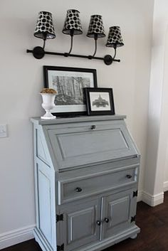 """Painted blue (Benjamin Moore """"Puritan Gray"""") secretary desk and sconce with mod…"""