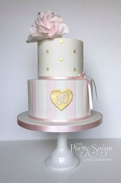 Pink stripes, gold polka dots and gold heart 30th birthday cake with modern sugar roses
