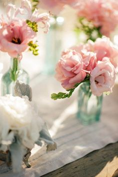 love these little bottles of roses for escort cards classic pink roses photography by emily blake emilyblakephotocom floral design by rolling hills
