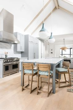 large kitchen island with pops of blue   house tour on coco kelley