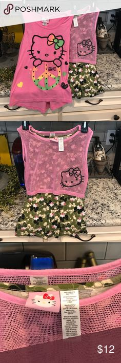Two Hello Kitty girls size 10/12 shirts Two Hello Kitty size girls 10/12 shirts. Hello Kitty Shirts & Tops Tank Tops