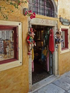 Entrance to a shop in the village of Oia in Santorini, Greece. Santorini Greece, Visual Merchandising, Old World, Entrance, I Shop, Rustic, Instagram Posts, Painting, Shopping