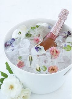 Easy to create floral ice cubes - perfect for chilling champagne at a shower. #DIYideas #bridalshower #flowers