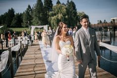 """Matt Shumate Photography bride and groom walking away """"riverfront park"""" """"floating dock"""" wedding ceremony """"just married"""""""