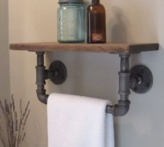 Industrial pipe hand towel rack with wood shelf.