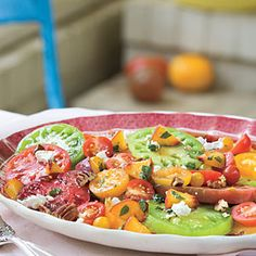 Salads - Heirloom Tomatoes with Fresh Peaches, Goat Cheese, and Pecans | MyRecipes.com