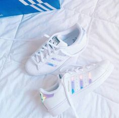 Wheretoget - White Adidas Superstar sneakers with holographic stripes