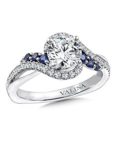R9766W-BSA-Diamond and blue sapphire criss-cross engagement ring mounting with side stones set in 14k white gold. Mounting to fit 1 ct. round center.