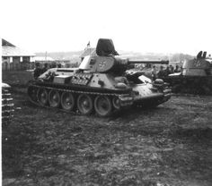 Captured Soviet tanks T-34B (Model 1941) and T-26C in the Finnish army, probably…