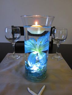 Would go great with my colors - Ocean Blue Tiger Lily Wedding Centerpiece Kit Blue Marbles and LED Light. $30.00, via Etsy.