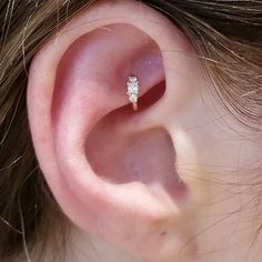 "Having a super fun day at work - just finished up with this cute rook piercing with a #mariatash 3/16"" diamond princess clicker! #legitbodyjewelry"