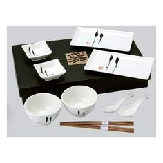 Japanese Sushi, Wasabi Plates, Bowls & Spoons Set in White & Black by Fuji. $74.95. The accompanying wooden chopsticks are sleek and durable. Classic porcelain sushi plates, wasabi dishes with Rice or Soup Bowls and Spoons are glazed in White with Black Pattern. Country of Origin: Japan. Comes in attractive black gift box for easy gift giving. Serve a tasty feast from the East in authentic style. Classic porcelain sushi plates, wasabi dishes with Rice or Soup Bowls and Spoons are...