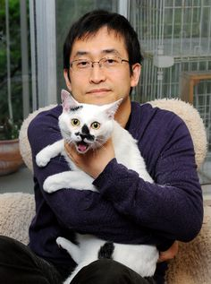 Portrait of horror manga writer and artist Junji Ito with his cat Tenmaru, Japan, 2013, photographer unknown.
