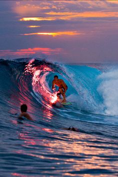 I love the way the light is reflecting off the wave, and the relationship between the two surfers