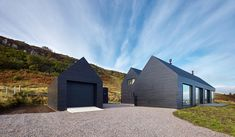 This wooden house designed by Dualchas Architects is situated close to a cliff with an amazing view over the bay of Dunvegan on the Isle of Skye, Scotland.