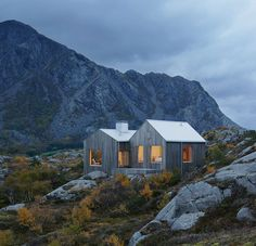 19 Examples Of Modern Scandinavian House Designs | The wood siding on this secluded island home blends right into the rocks and vegetation to keep the house private and unobtrusive.