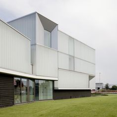 A translucent training centre in northern Italy has earned architects Iotti + Pavarani the Renzo Piano Foundation prize for the best Italian practice under 40. Lighting set behind a panelled glass exterior allows the two-storey Domus Technica to glow by night. Above photograph is by Roland Halbe Faceted recesses frame windows on each facade, while