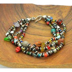 <li>4-strand bracelet showcases a vibrant design of colorful beads</li><li>Bracelet secures with a hook clasp and adjustable length chain</li><li>Jedando Modern Handicrafts</li>