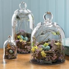 Just love these -  cloches with eggs in nests - Easter wedding display